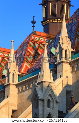 Sharp towers and colorful roof of St Matthias catholic church in Budapest, Hungary - stock photo