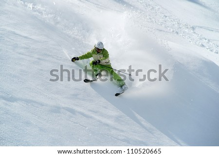 Sharp turn to ski in soft snow on the steep slope - stock photo