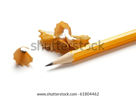 sharp yellow pencil and shavings isolated on white background - stock photo