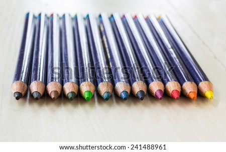 Sharpened colored pencils in a row. - stock photo