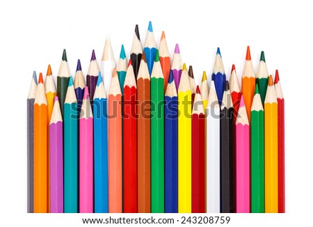 Sharpened colorful pencils arranged in rows - stock photo