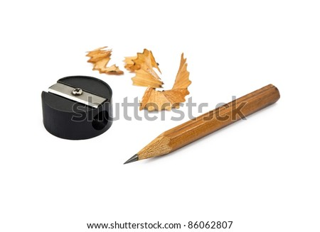 Sharpened pencil and wood shavings on white - stock photo