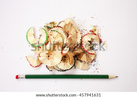 Sharpened pencil. Creative process. Colored wooden shavings - stock photo