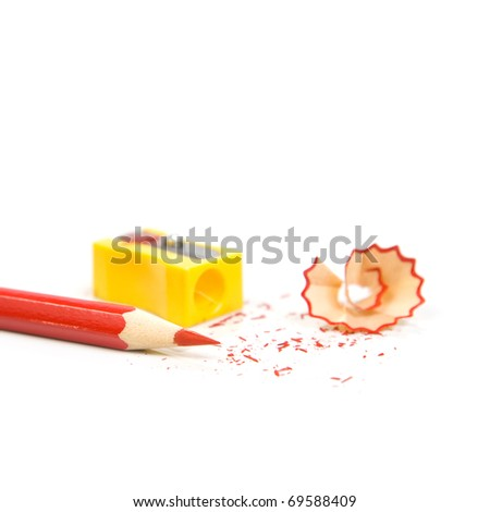 Sharpened pencil next to the sharpener and shavings. Isolated on white background - stock photo