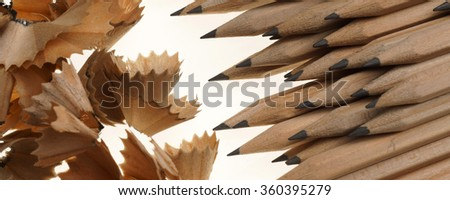 Sharpened pencils and wood shavings on isolated on white background  - banner / header edition - stock photo