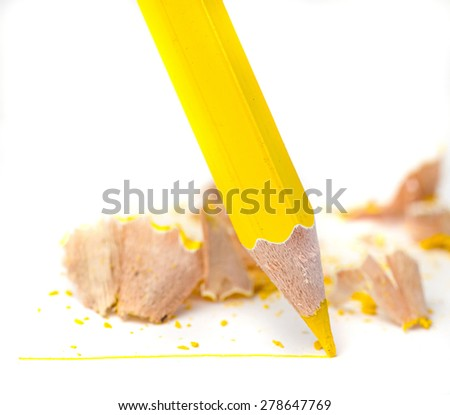 Sharpened yellow pencil draws a line on a white paper - stock photo