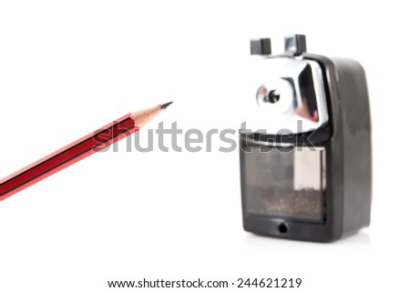 Sharpener and a pencil isolated on white background - stock photo