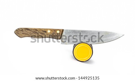 Sharpening a knife with a knife grinder on white background. - stock photo
