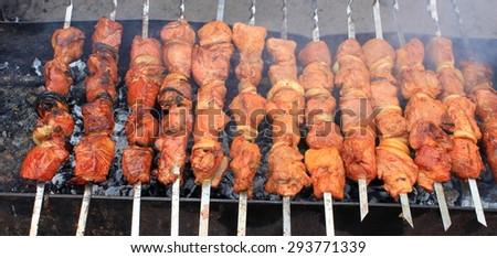 Shashlick laying on the grill closeup - stock photo
