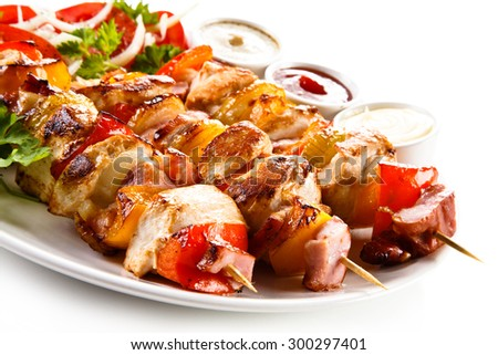 Shashlik - grilled meat and vegetables  - stock photo
