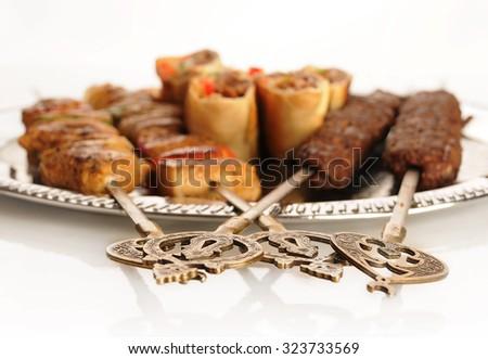 Shashlik, sharma, and shish kebab on the plate with oriental decoration - stock photo