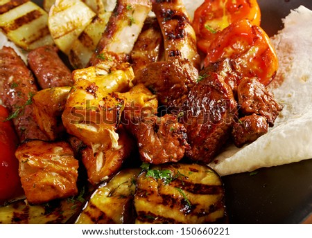 Shashlik (shish kebab). Various types  mat roasted with vegetable closeup