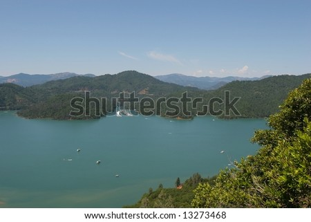 Shasta Lake is a reservoir created by the building of Shasta Dam in California, USA. Shasta Lake is the 3rd largest lake in California. - stock photo