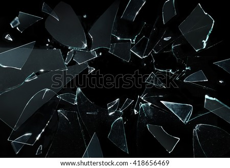 Shattered and broken glass pieces isolated on black - stock photo