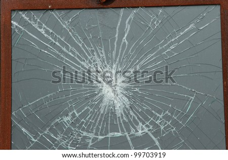 Shattered glass window pane in wooden frame