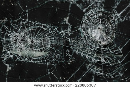 Shattered glass window with two holes