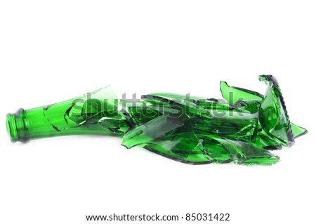 Shattered green champagne bottle isolated on the white background - stock photo