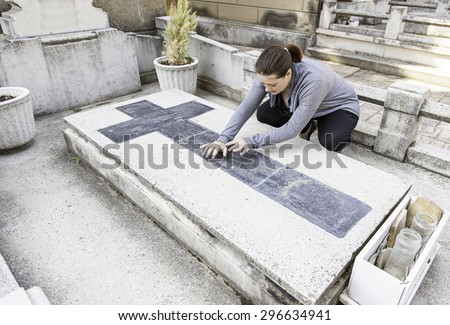 Shattered in tomb woman praying, religion and death - stock photo