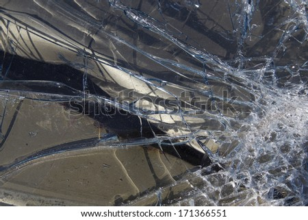 Shattered windshield glass, close-up. - stock photo
