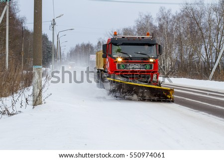Shatura, Moscow region, Russia - January, 7, 2017: Snow removal machine on a snow-covered road after high snow-storm in Moscow region, Russia