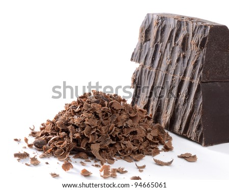 Shaved chocolate curls on white background - stock photo