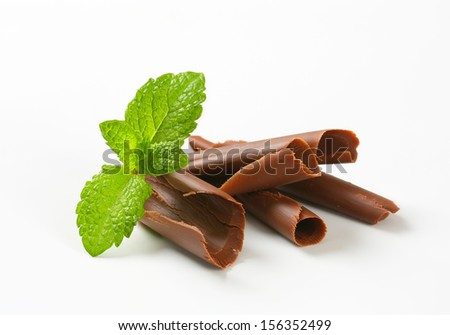 shaved chocolate curls with fresh mint - stock photo