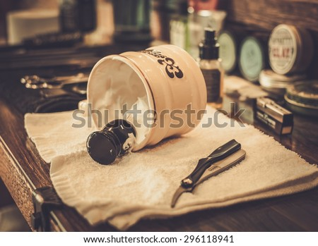 Shaving accessories in barber shop - stock photo
