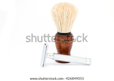 shaving brush with a razor on white