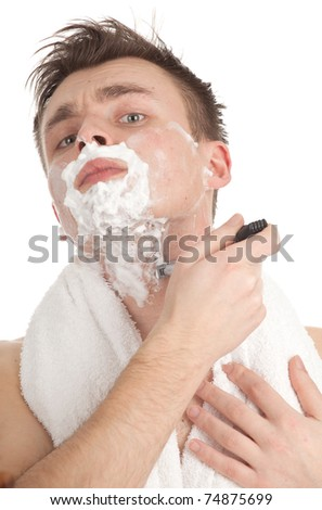 shaving handsome young man with foam and razor, series