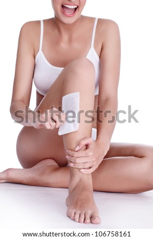 shaving legs, Young woman drawing  smiley in shaving foam - stock photo