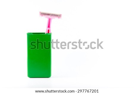 shaving razor in green box  isolated on a white background - stock photo