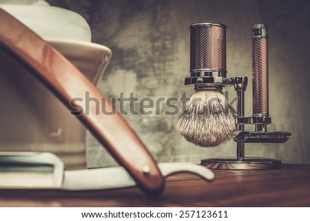 Shaving razors and bowl with foam on wooden background  - stock photo