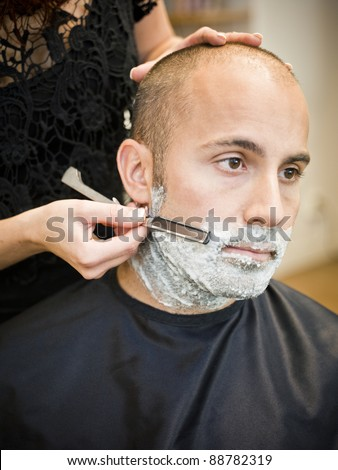 Shaving situation at the hair salon close-up