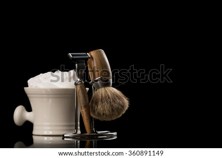 Shaving Tool on wooden Table and black Background - stock photo