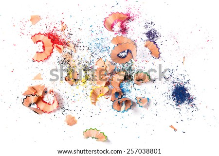 Shavings from multicolored pencils on white background - stock photo
