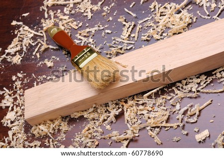 Shavings of wood, brick and brush painting - stock photo