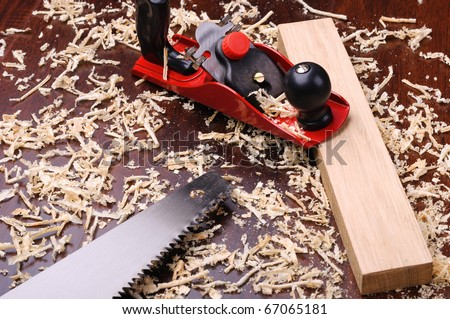 Shavings of wood, brick and red plane - stock photo