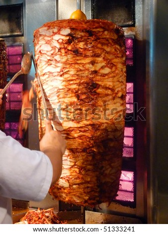 Shawarma is one of the most popular fast food dish in Middle Eastern Countries. - stock photo