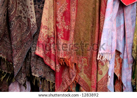 Shawls at a street market in Londone - stock photo