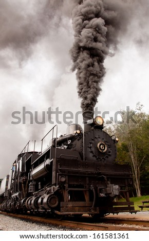 Shay engine 6 burns coal as it heads out of the station at Cass Scenic Railroad State Park in Cass, West Virginia. - stock photo