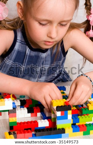She builds a house out of - stock photo