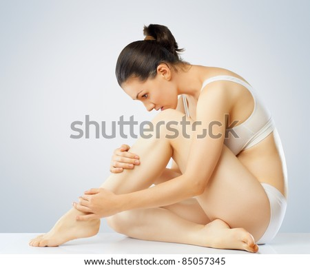she cares about her body - stock photo
