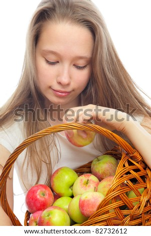 she chooses apples in the basket