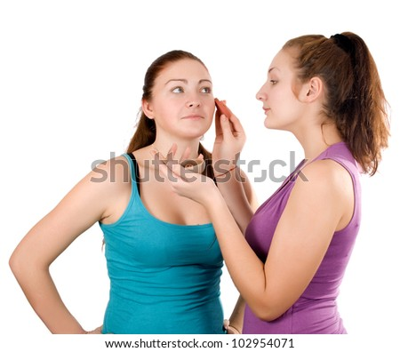 she does make-up girlfriend isolated on white background - stock photo