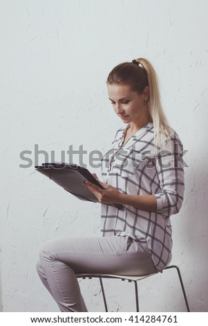 She fills the paper - stock photo