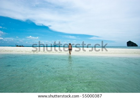 She funny alone in the beach Thailand. - stock photo