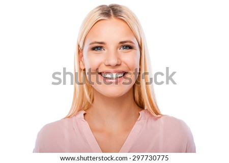 She got beautiful smile. Portrait of cheerful young woman looking at camera and smiling while standing against white background - stock photo