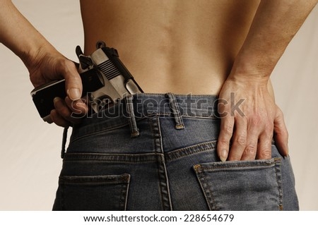 She Hides Her Gun - stock photo