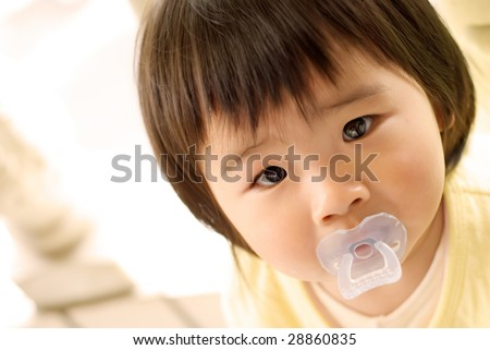 She is an asian baby and looked so beautiful. - stock photo