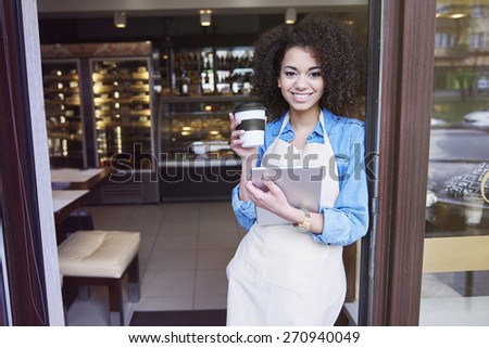 She is proud for her small coffee shop - stock photo